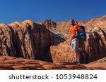 hiker on a trail in volcanic... | Shutterstock . vector #1053948824