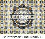 under review arabesque emblem....   Shutterstock .eps vector #1053953024