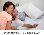 couple spending time in bed | Shutterstock . vector #1053961124