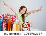 little girl shopping | Shutterstock . vector #1053962387