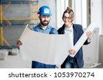 foreman expertising the... | Shutterstock . vector #1053970274