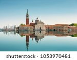 San Giorgio Maggiore island in Venice, Italy. Beautiful view of Venice with mirror reflection in water surface. Venice landmark. Panorama of Venice on a sunny summer day.