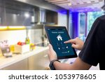 hands holding smart tablet with ... | Shutterstock . vector #1053978605