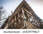 a wooden house after a fire | Shutterstock . vector #1053979817