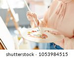 girl with palette mixing... | Shutterstock . vector #1053984515