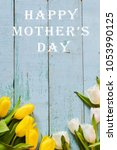 """Small photo of Background, greeting card: bouquet of multicolored tulips on a light background. Layout, mocap, for inscription: """"Happy mothers day"""""""