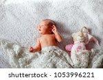a newborn baby lies with a bear ... | Shutterstock . vector #1053996221