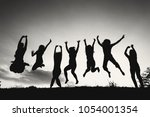 group of people jumping against ... | Shutterstock . vector #1054001354