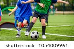 children play sports. kids... | Shutterstock . vector #1054009961