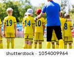 youth football coach talking to ... | Shutterstock . vector #1054009964
