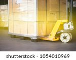 pallet goods with manual... | Shutterstock . vector #1054010969