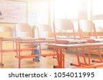 empty classroom with school... | Shutterstock . vector #1054011995