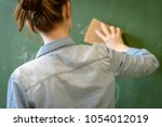 female teacher or a student... | Shutterstock . vector #1054012019