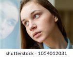 young depressed lonely female... | Shutterstock . vector #1054012031