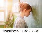 teenager girl in math class...   Shutterstock . vector #1054012055