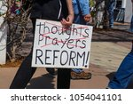 protest sign held by... | Shutterstock . vector #1054041101