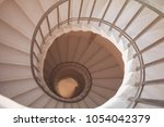 view to the circle spiral... | Shutterstock . vector #1054042379