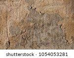 plaster grunge wall in brown... | Shutterstock . vector #1054053281