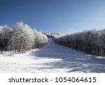 empty ski track  skiing ... | Shutterstock . vector #1054064615