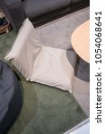 Small photo of Living corner in modern style with grey foldable cushion on carpet.