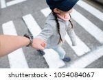 father and daughter walking... | Shutterstock . vector #1054084067