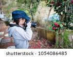 little girl to take a picture | Shutterstock . vector #1054086485