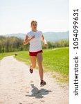 woman runner runs   workout in...   Shutterstock . vector #1054099631