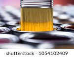 tin cans with paint  brushes... | Shutterstock . vector #1054102409
