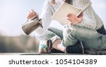 girl drinks coffee and reads... | Shutterstock . vector #1054104389