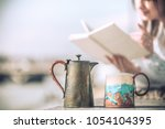 girl drinks coffee and reads... | Shutterstock . vector #1054104395