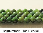 natural green jade nephrite... | Shutterstock . vector #1054105301