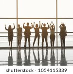 backs of triumphant men and... | Shutterstock . vector #1054115339