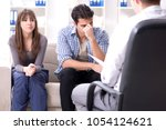 family visiting psychologist... | Shutterstock . vector #1054124621