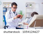 patient getting blood... | Shutterstock . vector #1054124627