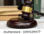 judge gavel beside pile of... | Shutterstock . vector #1054139477