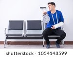 desperate man waiting for his... | Shutterstock . vector #1054143599