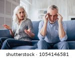 senior couple at home. handsome ... | Shutterstock . vector #1054146581