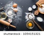 baking ingredients. bowl  eggs  ... | Shutterstock . vector #1054151321