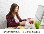 creative designer working on a... | Shutterstock . vector #1054158311