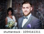 wedding. bridegroom or fiance... | Shutterstock . vector #1054161311