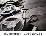 retro audio reels and cassette... | Shutterstock . vector #1054164251