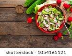 vegetarian vegetable salad of... | Shutterstock . vector #1054165121