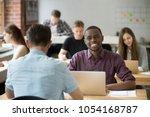 happy african american worker...   Shutterstock . vector #1054168787