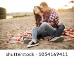 loving couple embracing on the... | Shutterstock . vector #1054169411