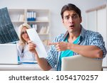 male patient angry at expensive ... | Shutterstock . vector #1054170257