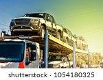 transportation of new cars | Shutterstock . vector #1054180325