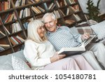 senior couple together at home... | Shutterstock . vector #1054180781