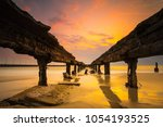 the scenic of sunrise at the... | Shutterstock . vector #1054193525