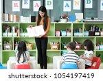 young asian woman teacher... | Shutterstock . vector #1054197419