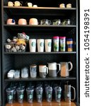 Small photo of Bangkok, Thailand -March 24,2018 : Starbucks branded and logo drinkware assort and display on shelf for sale as collectible souvenirs in a Starbucks coffee shop Bangkok, Thailand.